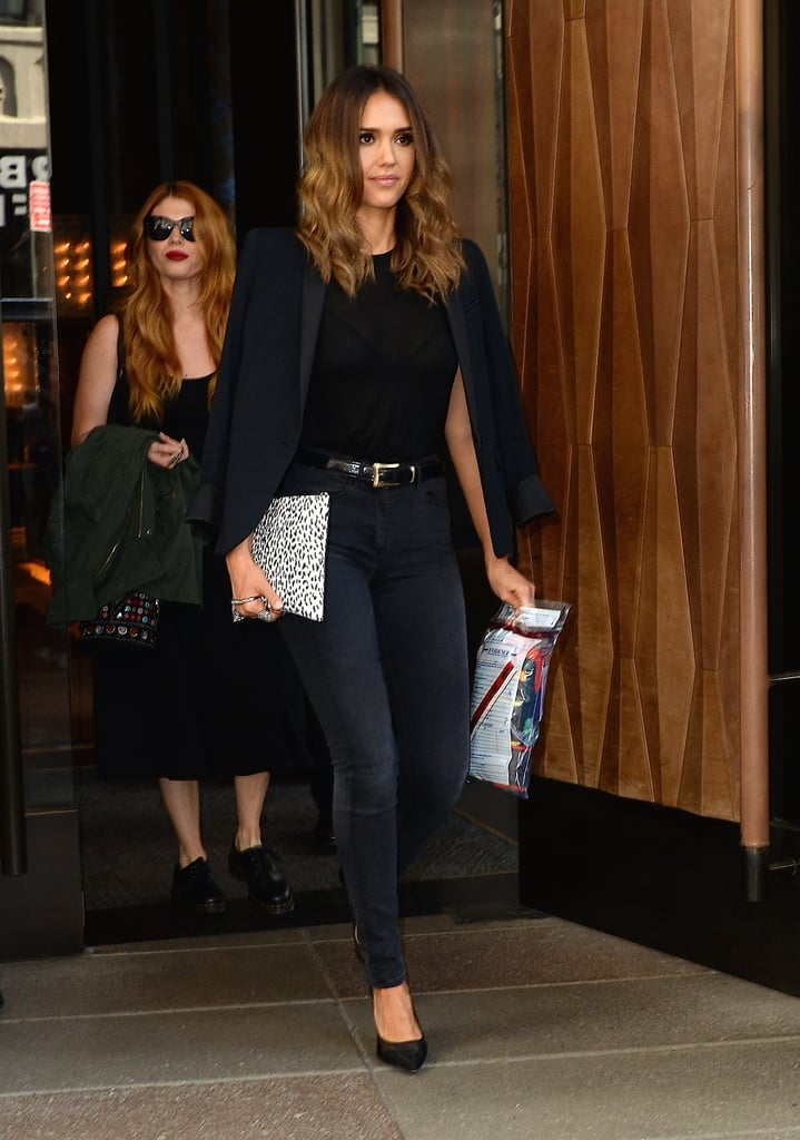 Jessica took her black jeans beyond basic with the help of a statement belt, pumps, and, of course, a blazer, which she then draped over her shoulders.