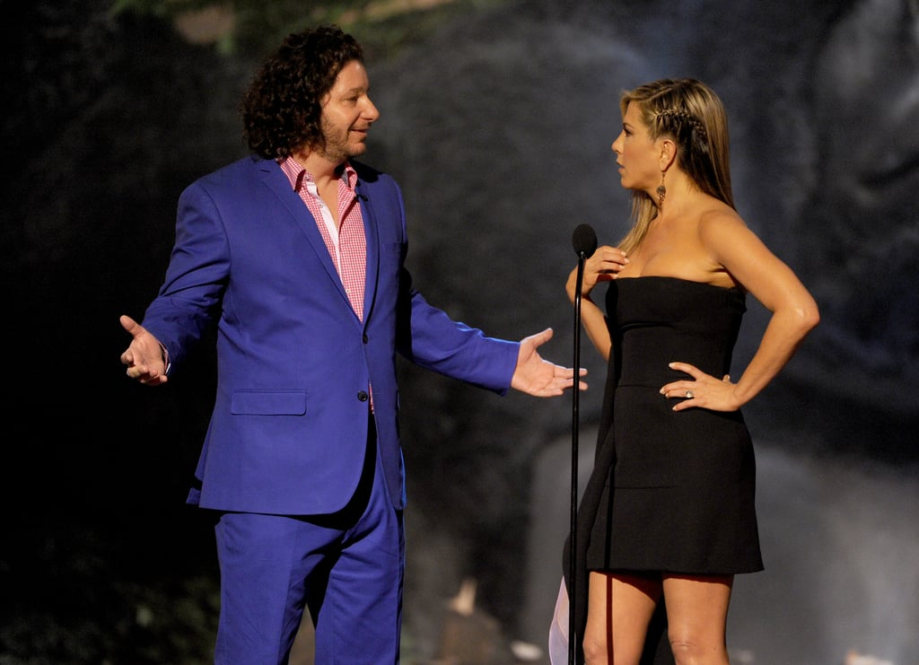 Jennifer Aniston and Jeffrey Ross told jokes on stage.