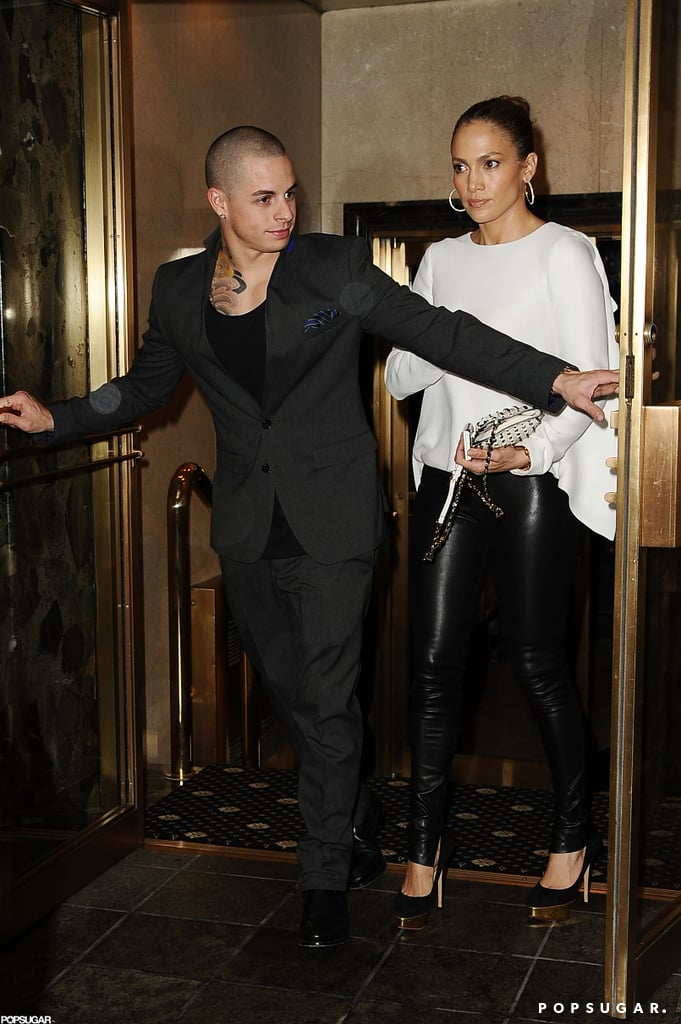 Jennifer Lopez walked out of the doors that Casper Smart held for her in NYC.