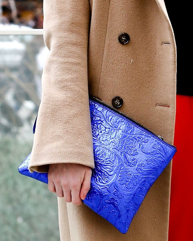 We love the floral detailing on the bright blue clutch.