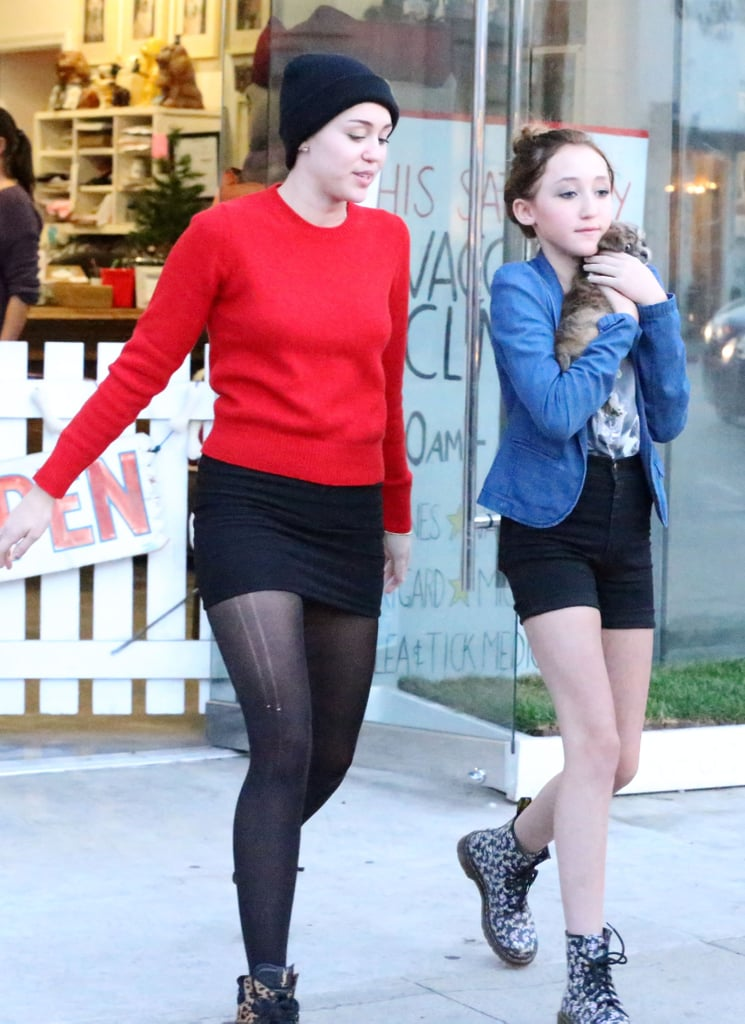 Miley Cyrus and her sister carried a puppy out of an LA pet store.