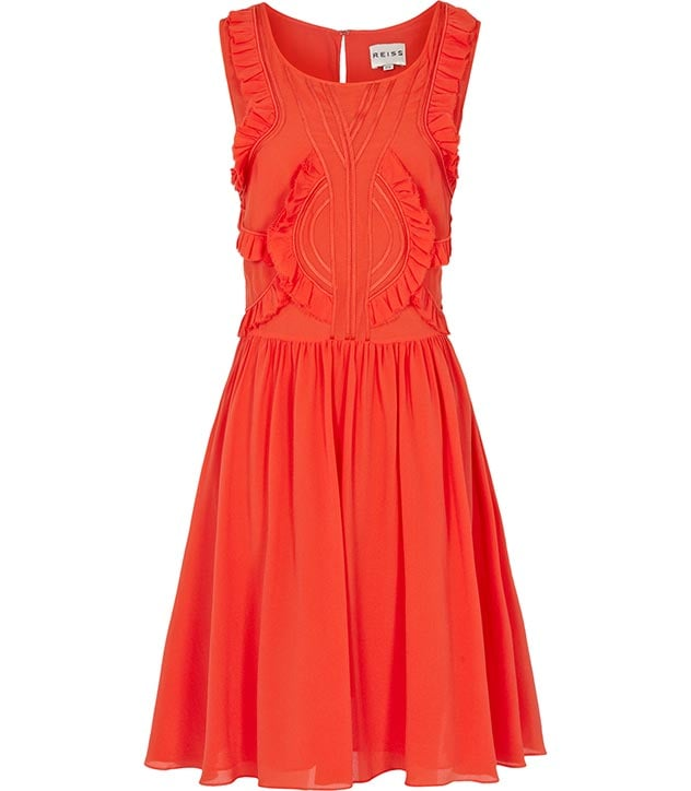 The bold orange color of this ruffled Reiss style ($340) is sure to stand out.