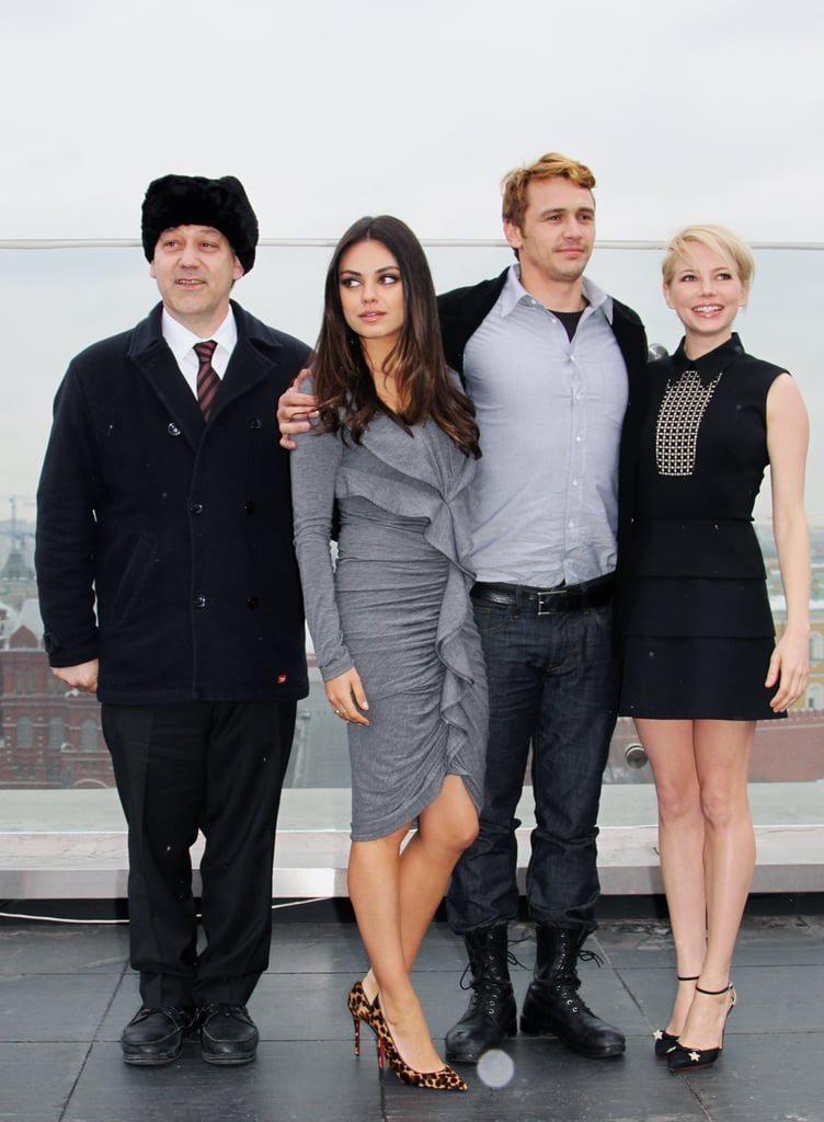 Michelle Williams, Mila Kunis, and James Franco posed with director Sam Raimi for an Oz the Great and Powerful photocall in Moscow.
