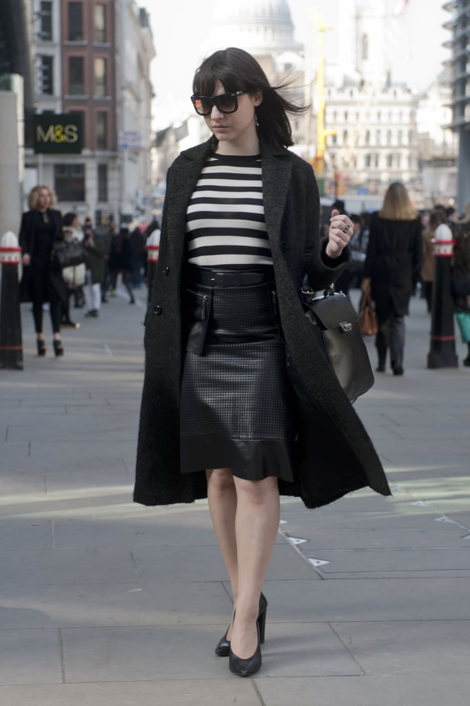 This attendee had one foot in Winter with a classic black coat, but the other foot stepping into Spring via sleek white and black stripes to tpo her leather skirt.