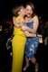 Lena Dunham planted a kiss on Kat Dennings at the Grammy Awards in LA on Sunday.