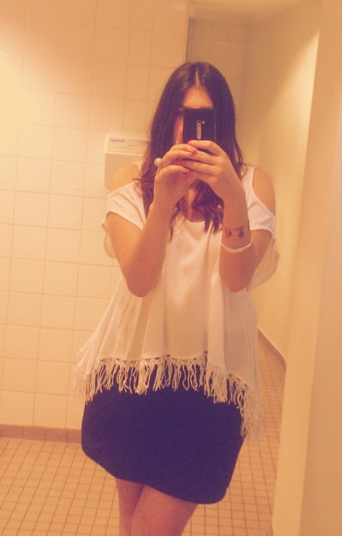 Welcome back, summer! Wearing a loose white top from Bali gets me in the mood for long, hot days.