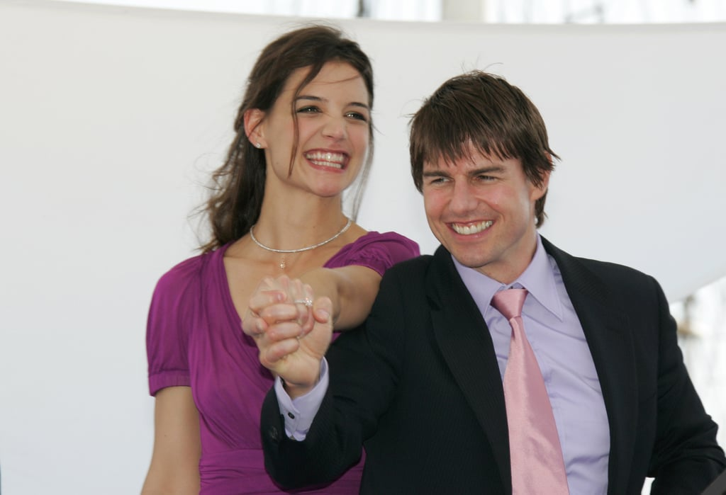 Katie Holmes and Tom Cruise showed off her new engagement ring while at a Paris press conference for War of the Worlds in June 2005.
