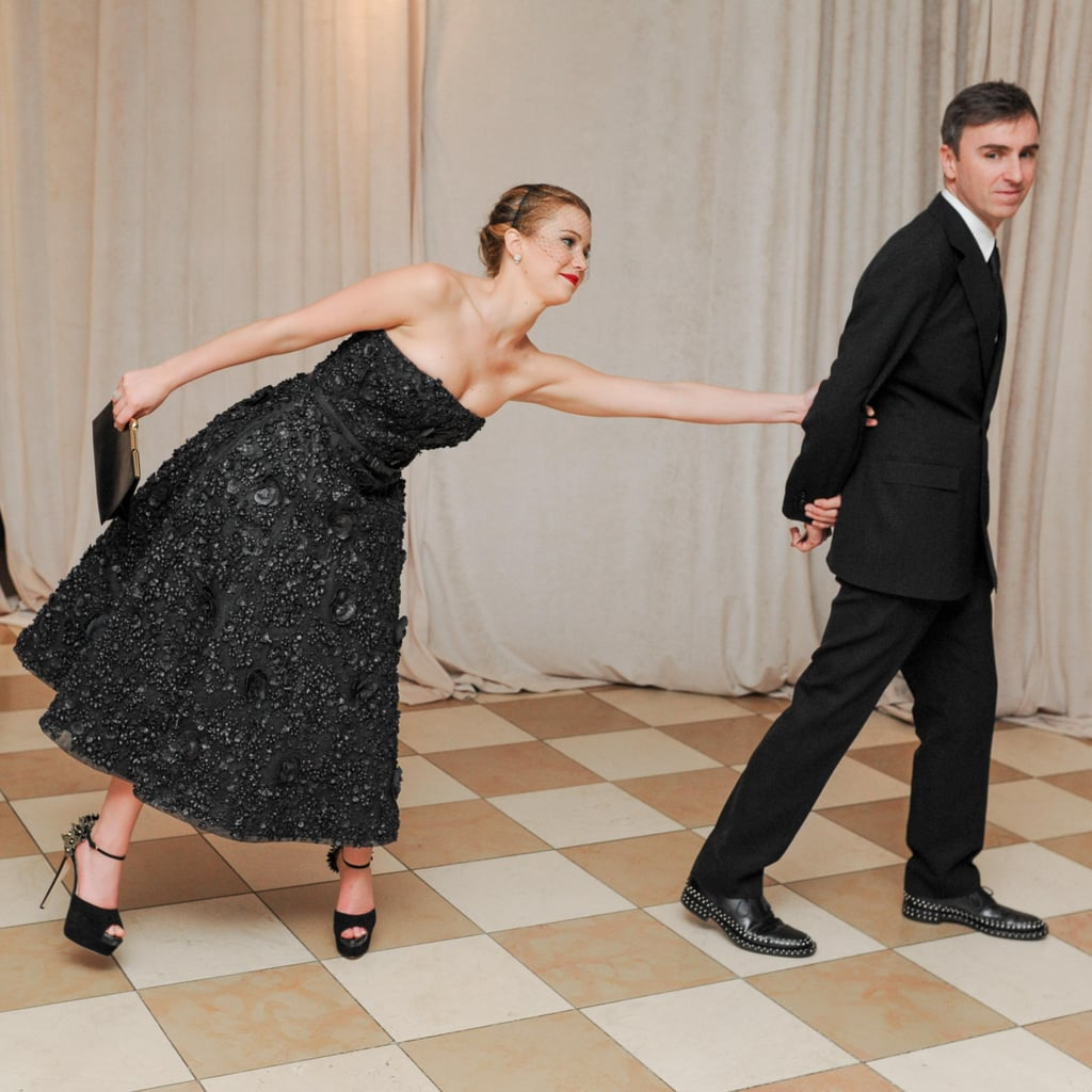 Jennifer Lawrence leaned over to get designer Raf Simons's attention. Source: Billy Farrell/BFANYC.com