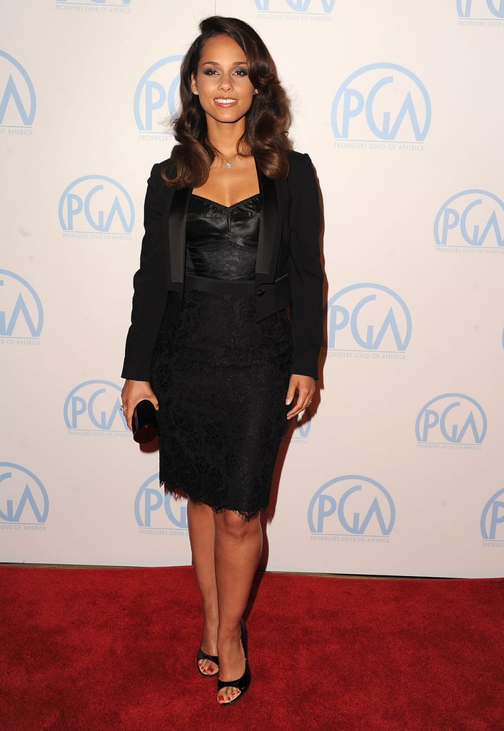 Alicia Keys opted for a Dolce & Gabbana black satin bustier dress and cropped tuxedo jacket. She complemented this sexy look with Giuseppe Zanotti heels and a black Jimmy Choo clutch.