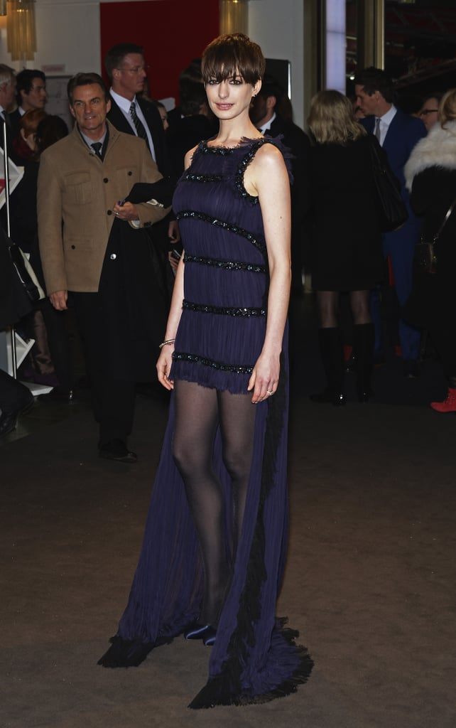 Anne Hathaway showed off a spotlight-worthy purple high-low gown and matching satin Casadei pumps for the Les Misérables premiere at the 63rd Berlinale International Film Festival.