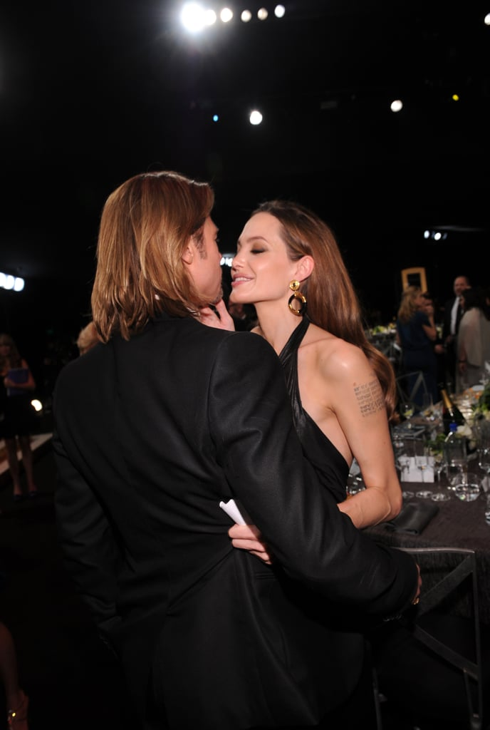 Brad Pitt and Angelina Jolie couldn't keep their hands off each other during the January 2012 SAG Awards.
