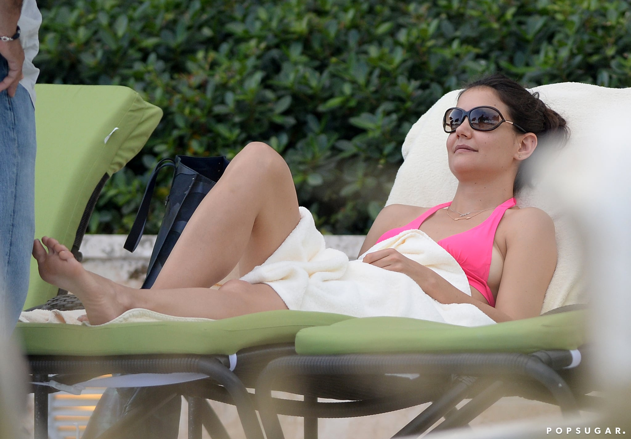 Katie Holmes relaxed poolside in Miami.