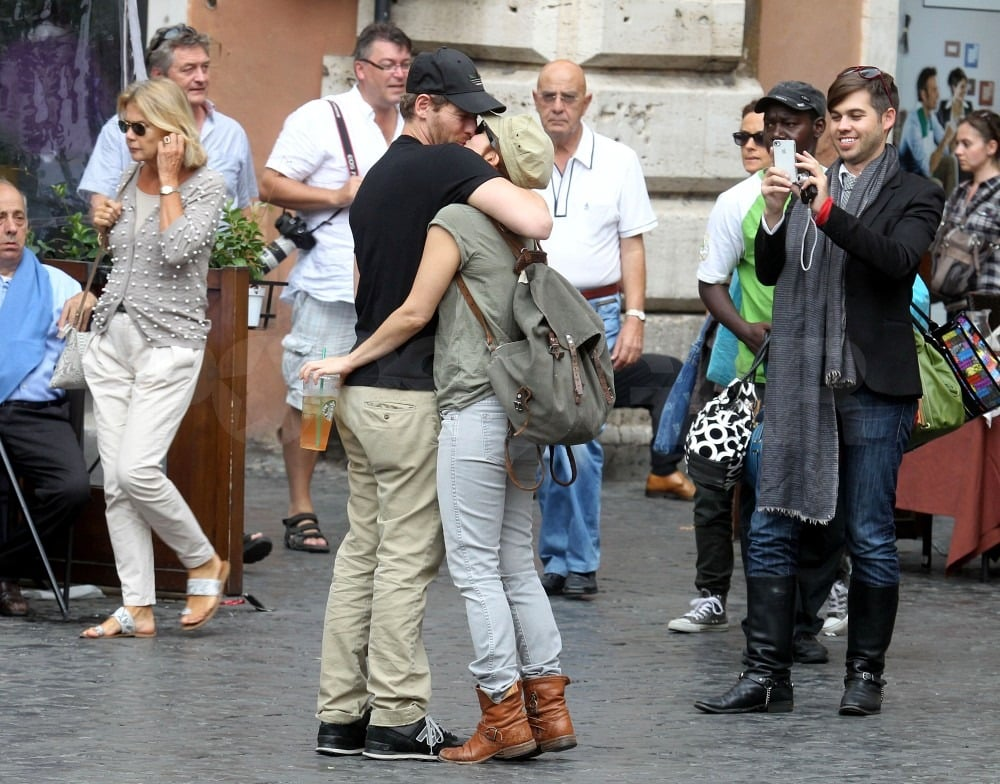 The couple stopped to share a kiss in the middle of town.