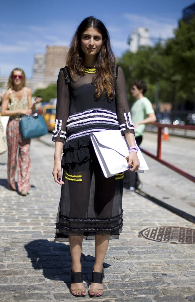 Offset a sheer black Summer dress with an oversized white envelope clutch. The menswear-inspired portfolio will toughen up its more feminine complement. Photo courtesy of Phil Oh