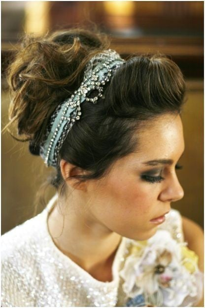 "This chic rhinestone hair wrap (US$155) has a beautiful vintage feel and it looks great with a twisted bouffant. Plus, it's a perfect ""something blue."""