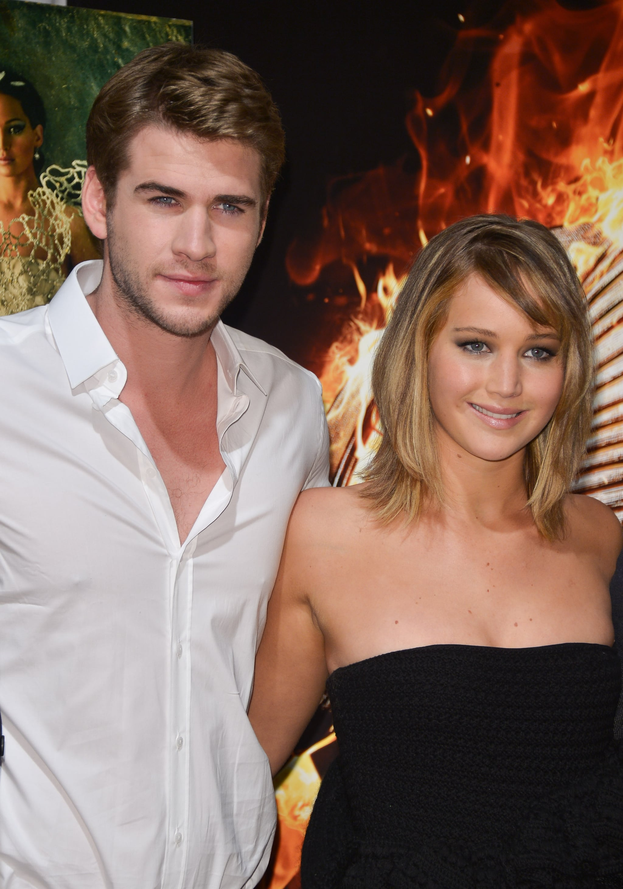 Liam Hemsworth and Jennifer Lawrence attended a Catching Fire photocall.