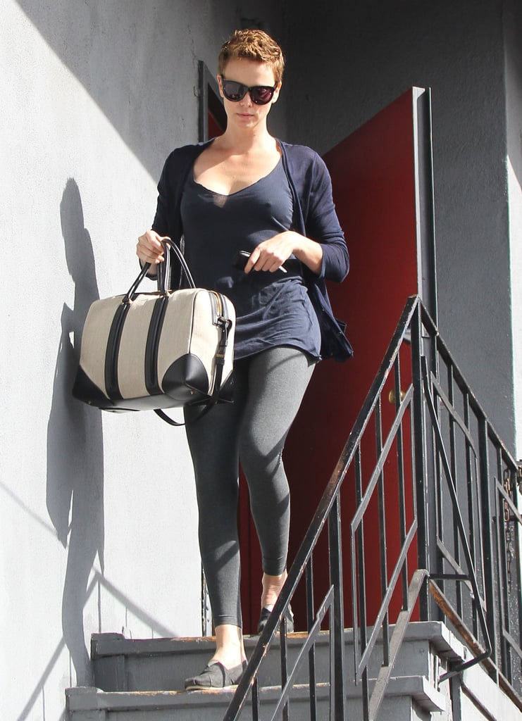 While running errands in LA, Charlize Theron's black-and-beige Givenchy Lucrezia tote dressed up her navy and gray basics.