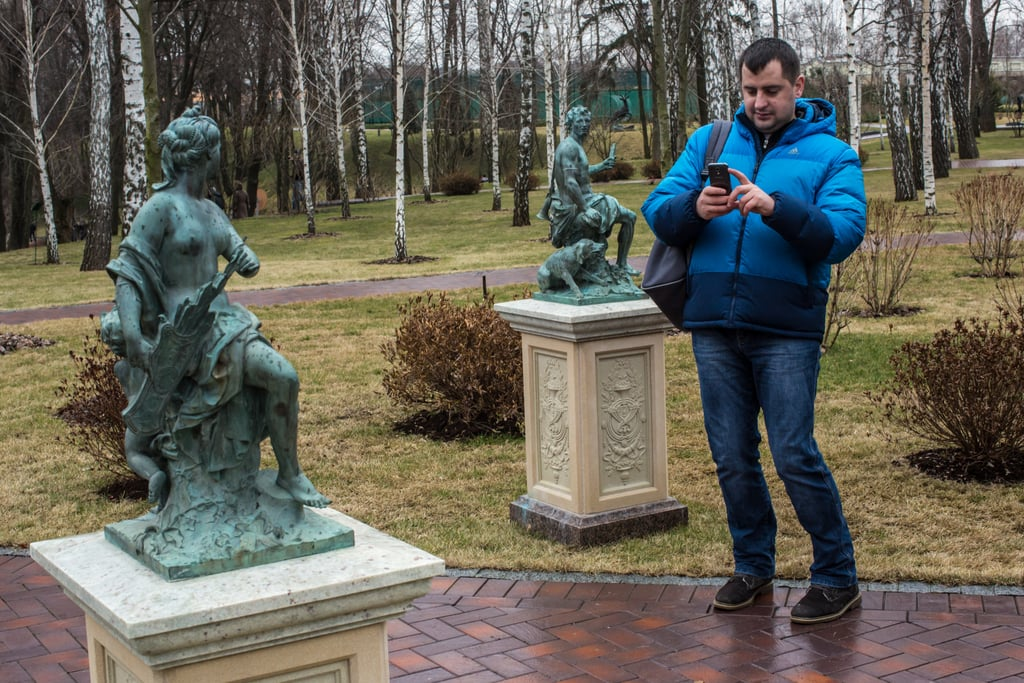A man was seen photographing a statue on the estate.