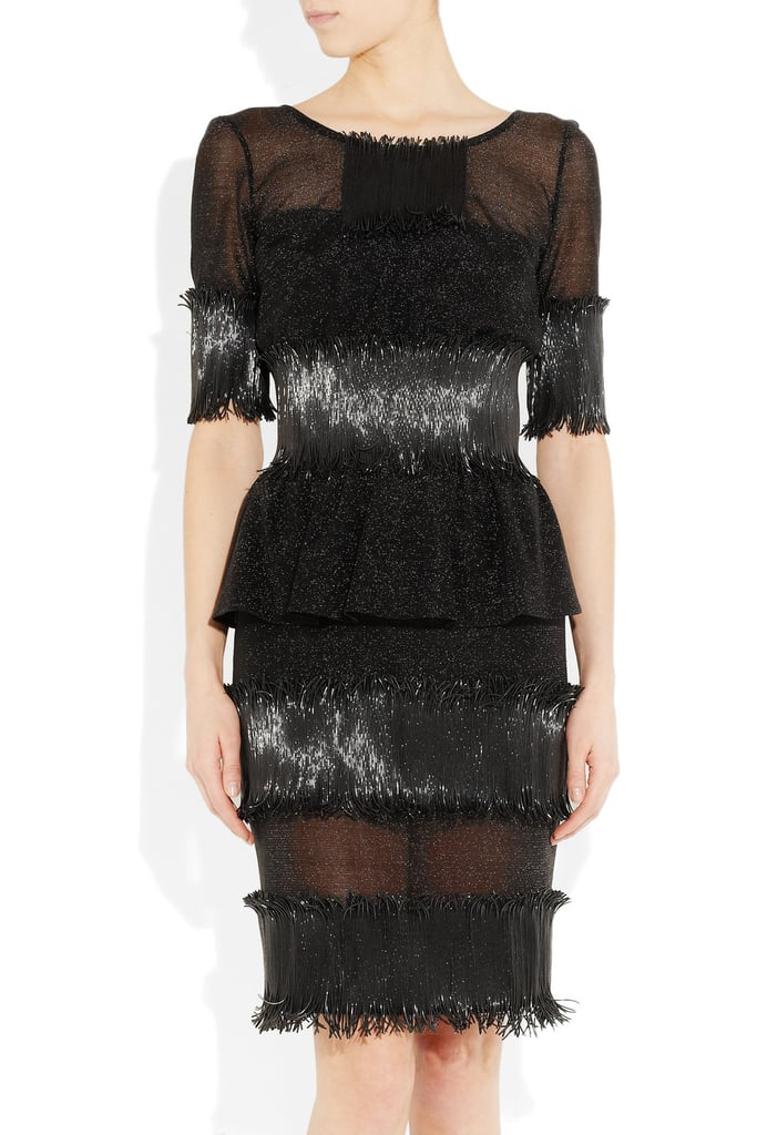 """It's hard for me to put into words how much I adore this Karl Lagerfeld Appliqued Mesh Dress ($3,910); it's basically a show piece, and in the words of Britney Spears, I'm a """"put-on-a-show"""" kind of girl. While it's obviously a splurge, I think it's worth its weight in gold (or in this case, silver). I'd style it up with basic black pumps, a metallic clutch, and a seriously smoky eye. — Britt Stephens, assistant editor"""