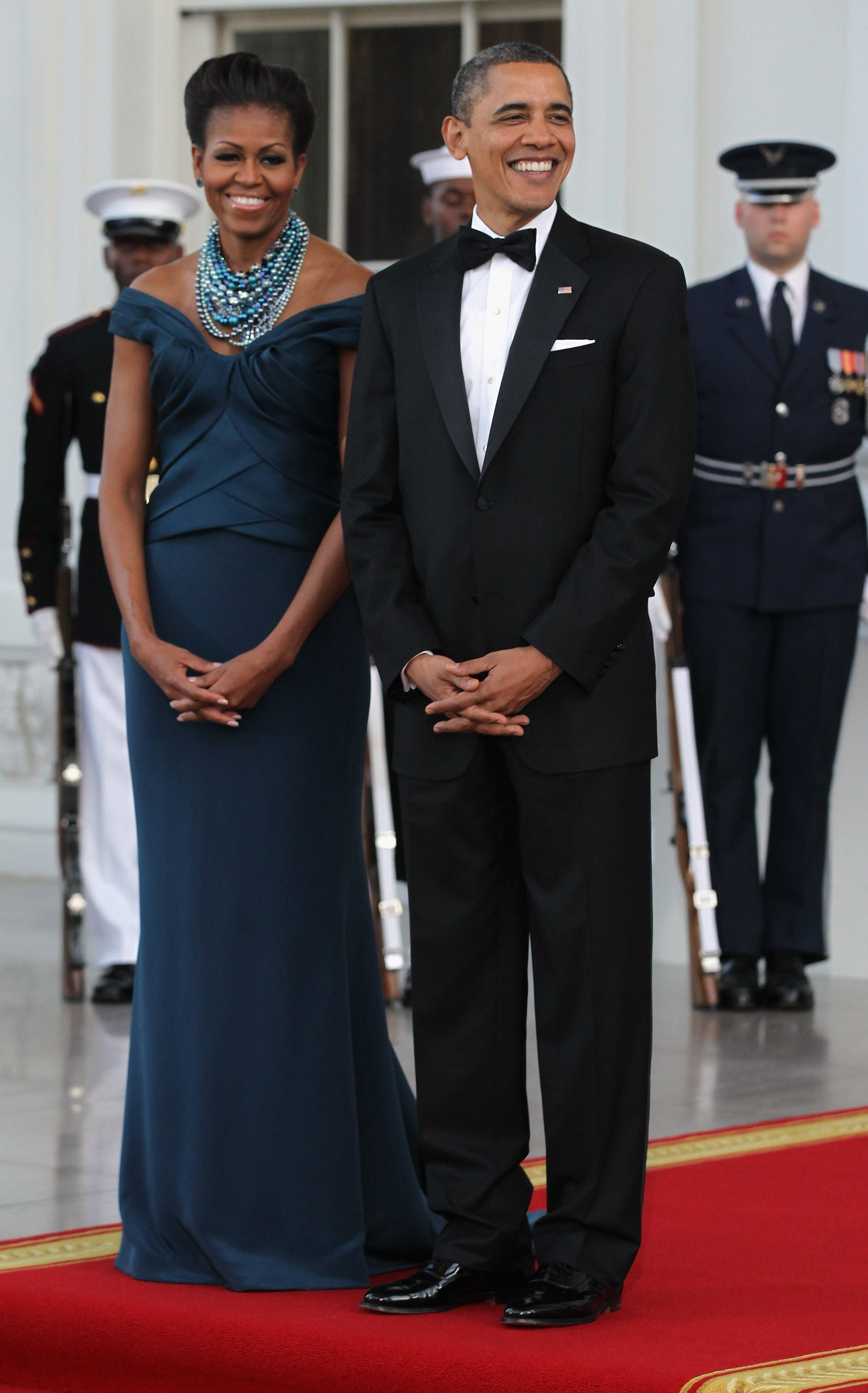 President and Mrs. Obama hosted the visit of UK Prime Minister David Cameron and his wife, Samantha, in 2012. Michelle looked positively glowing in an elegant Marchesa off-the-shoulder gown, accessorized with strands of Tom Binns pearls.