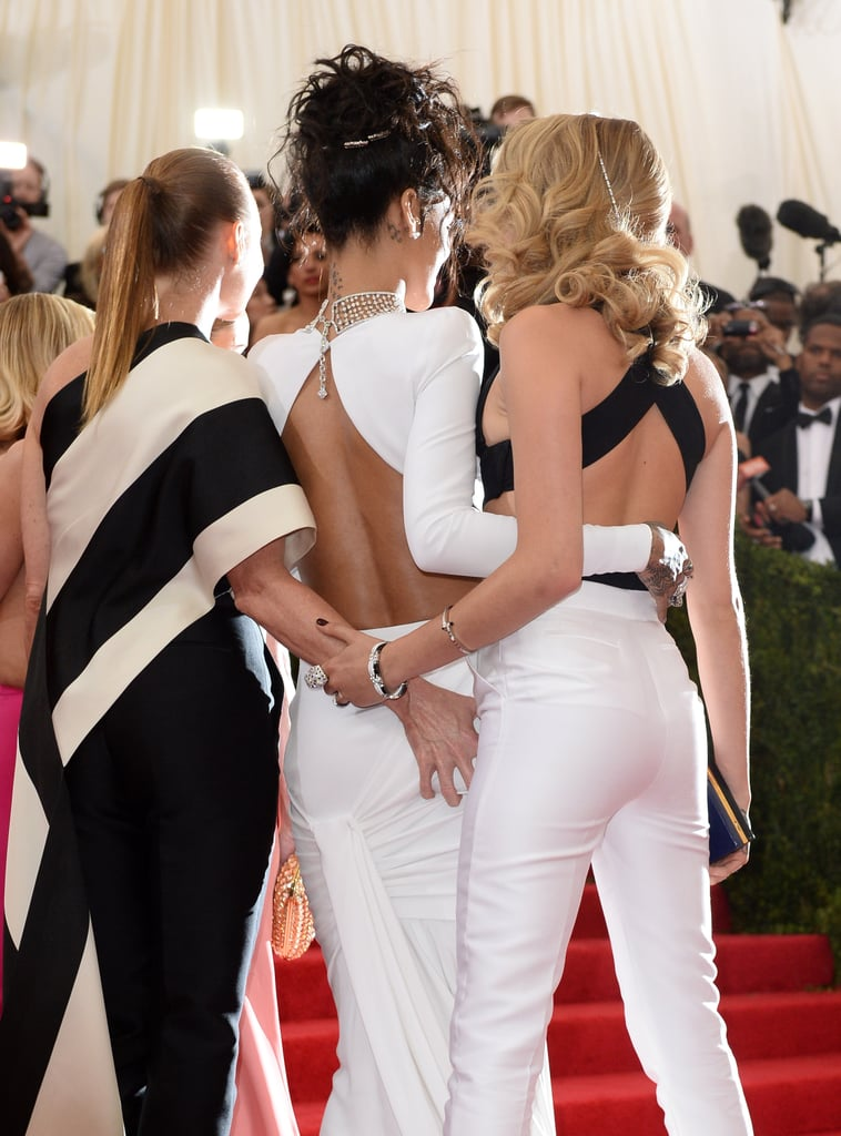 Stella McCartney copped a feel of Rihanna while posing for photos with Cara Delevingne.