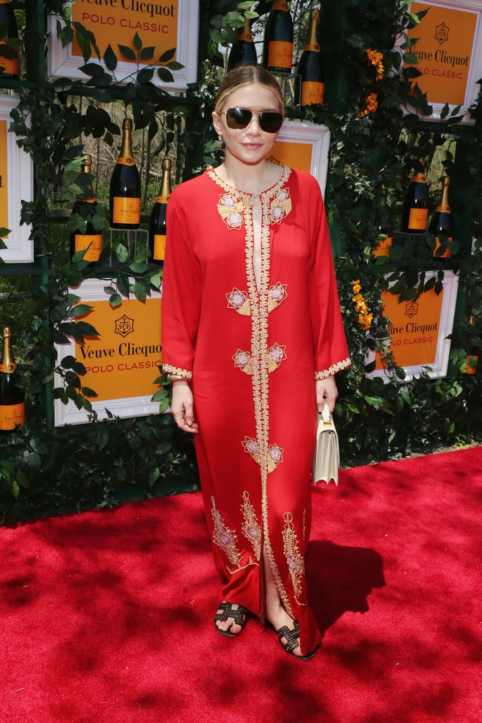 Always willing and ready when it comes to fashion chances, Ashley skipped flirty sundresses in favor of a blazing caftan with golden closures.