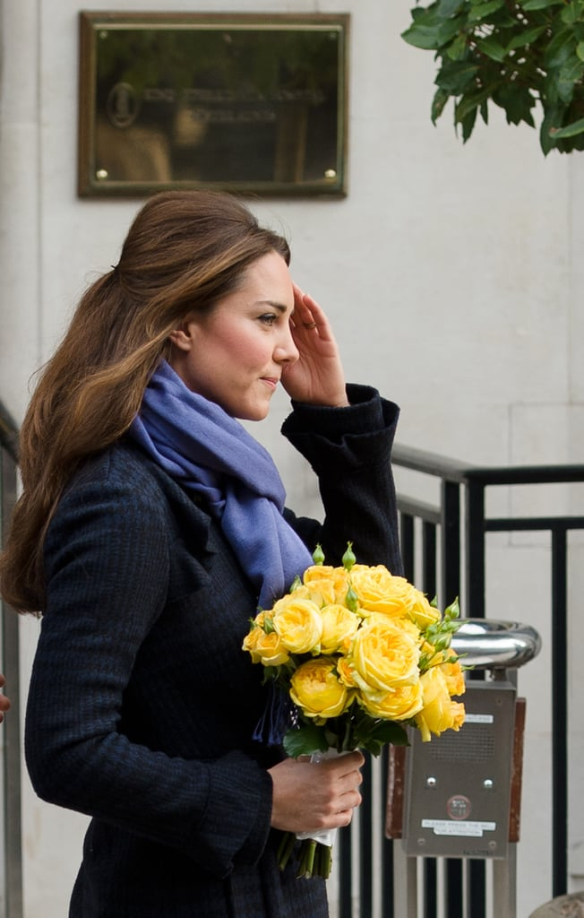 Kate Middleton carried yellow flowers in London.