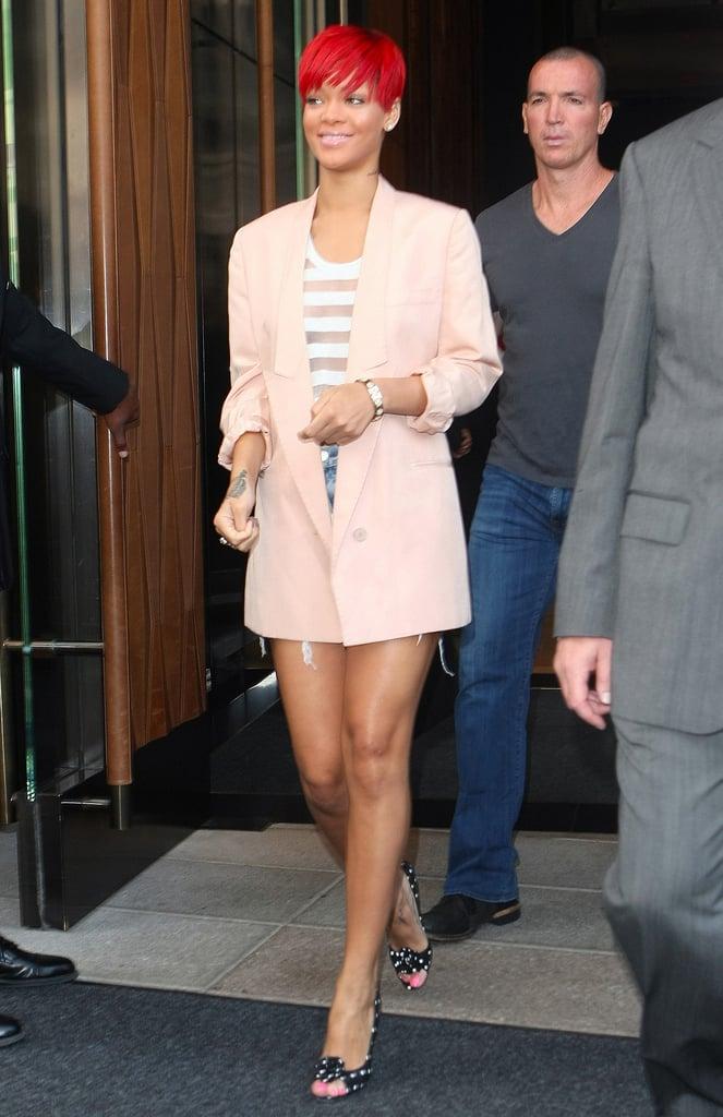 Rihanna chose a pastel palette —pink Stella McCartney blazer, white sheer-stripe blouse, and light denim cutoffs — for an August 2010 NYC trip.