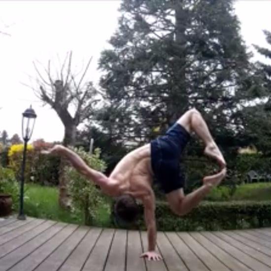 Man Doing One-Handed Handstands