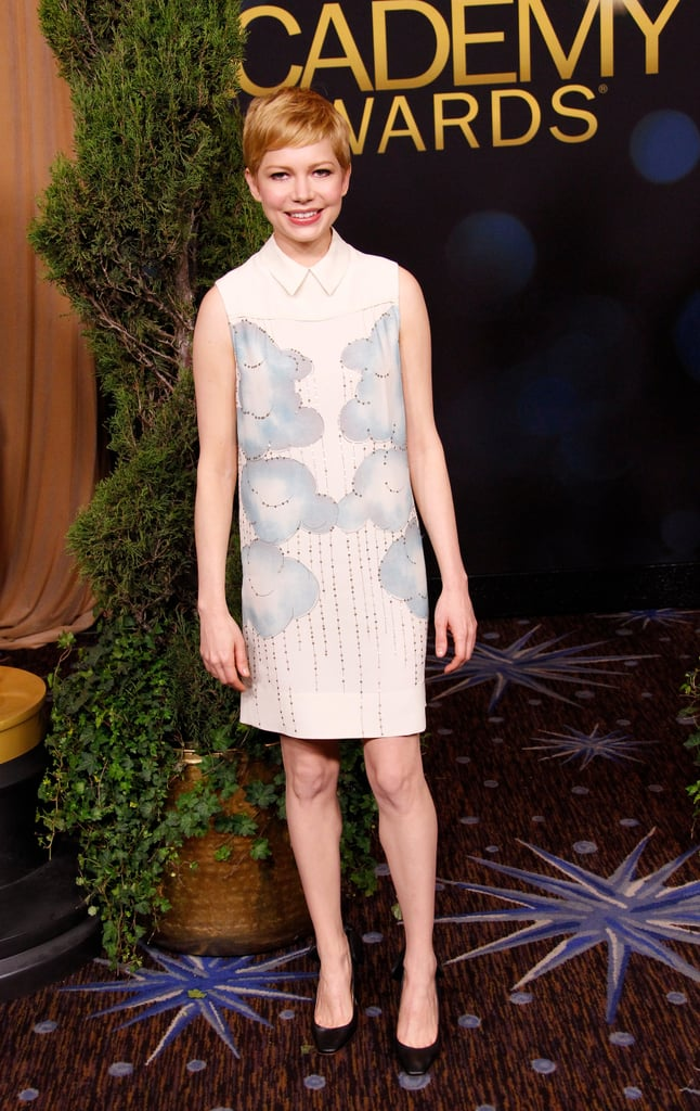 Michelle Williams looked absolutely adorable in a sleeveless, collared ivory Victoria by Victoria Beckham shift dress. The silver lining? The metallic-embellished rain clouds emblazoned onto the dress front. She added a classic black round-toe pump to finish off the luncheon look.