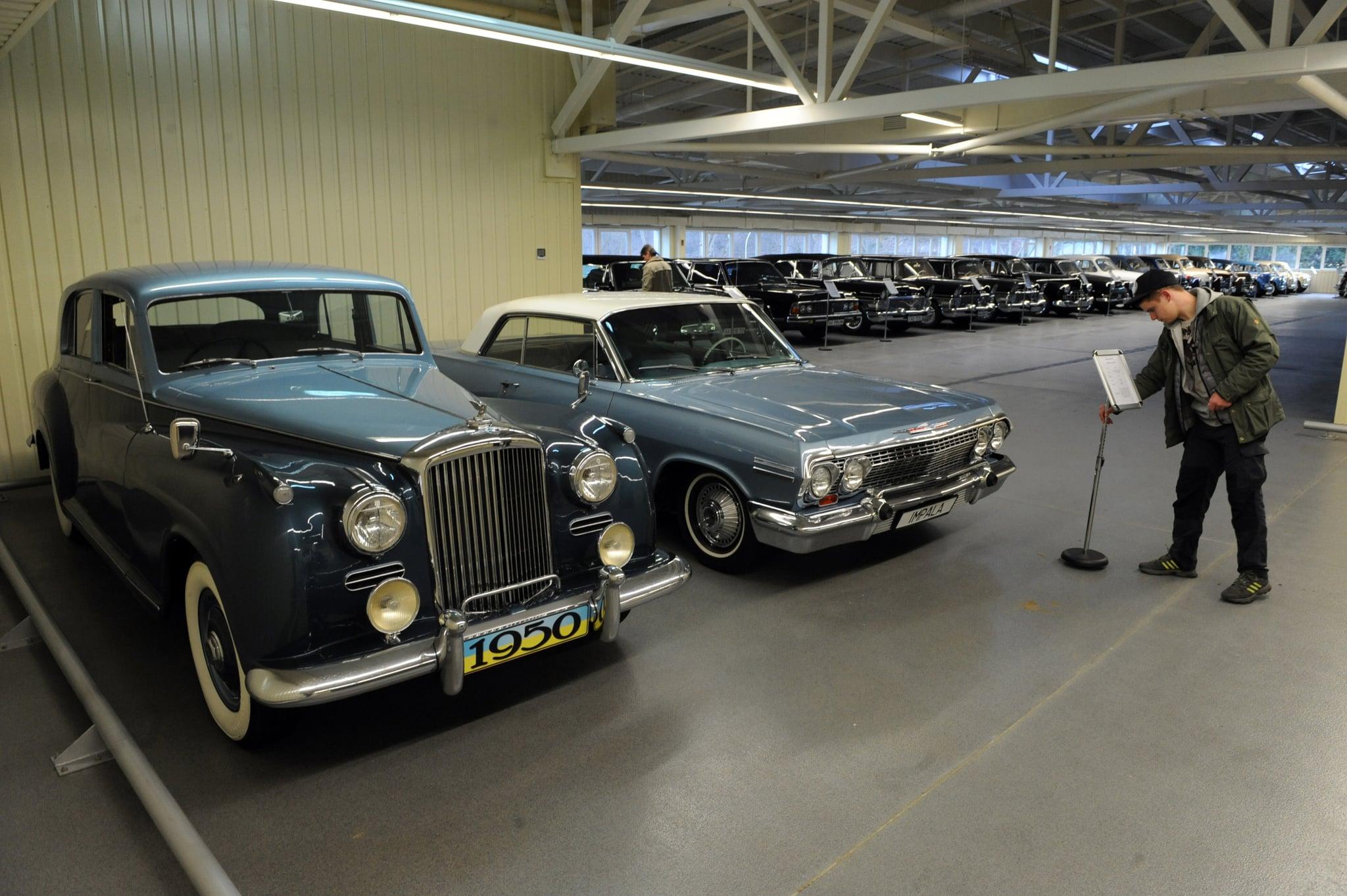 Vintage cars lined a giant garage.