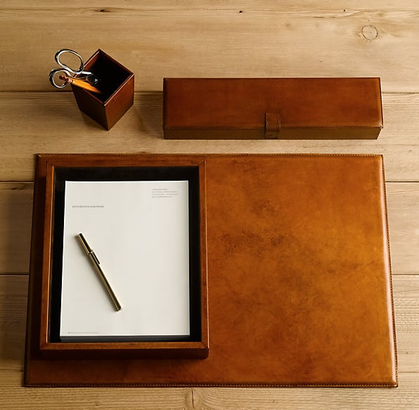 All of my co-workers can attest to how I've been talking about getting a proper desk set to organize my life at the office. I am such a sucker for the color of these Restoration Hardware artisan leather desk accessories ($35-$139), which you know will only look better as you spill some ink on them.   — Robert Khederian, fashion editorial assistant