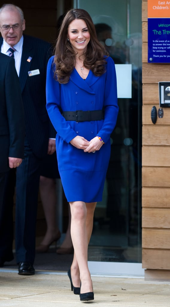 Catherine, Duchess of Cambridge, arrived to officially open The Treehouse Children's Hospice in a bright blue Reiss suit dress, cinched with a wide black belt.
