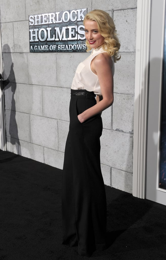 Amber Heard worked her fashionable look on the black carpet.
