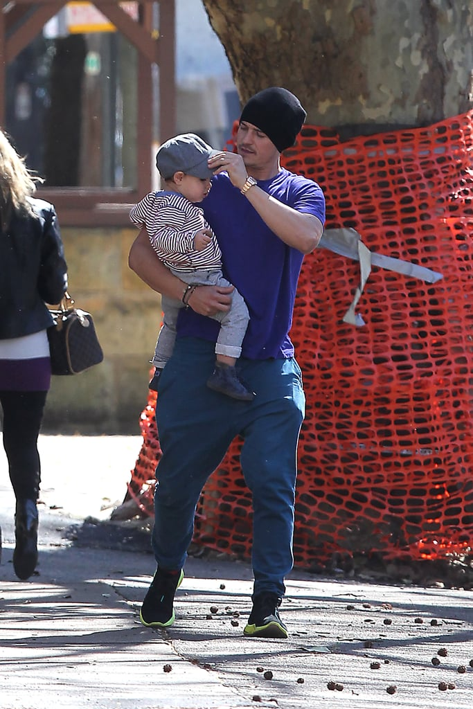 Orlando Bloom adjusted Flynn's cap during a walk in Sydney in August 2012.