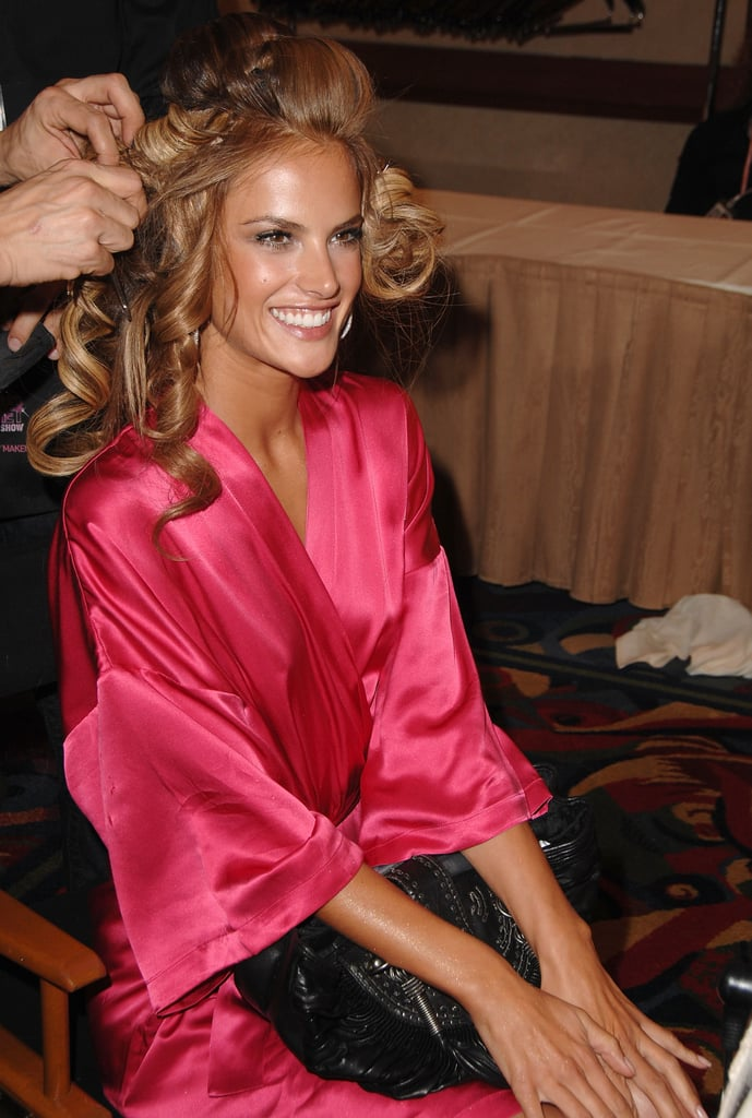 Alessandra Ambrosio sat pretty in her pink silk robe while getting her hair done in 2007.