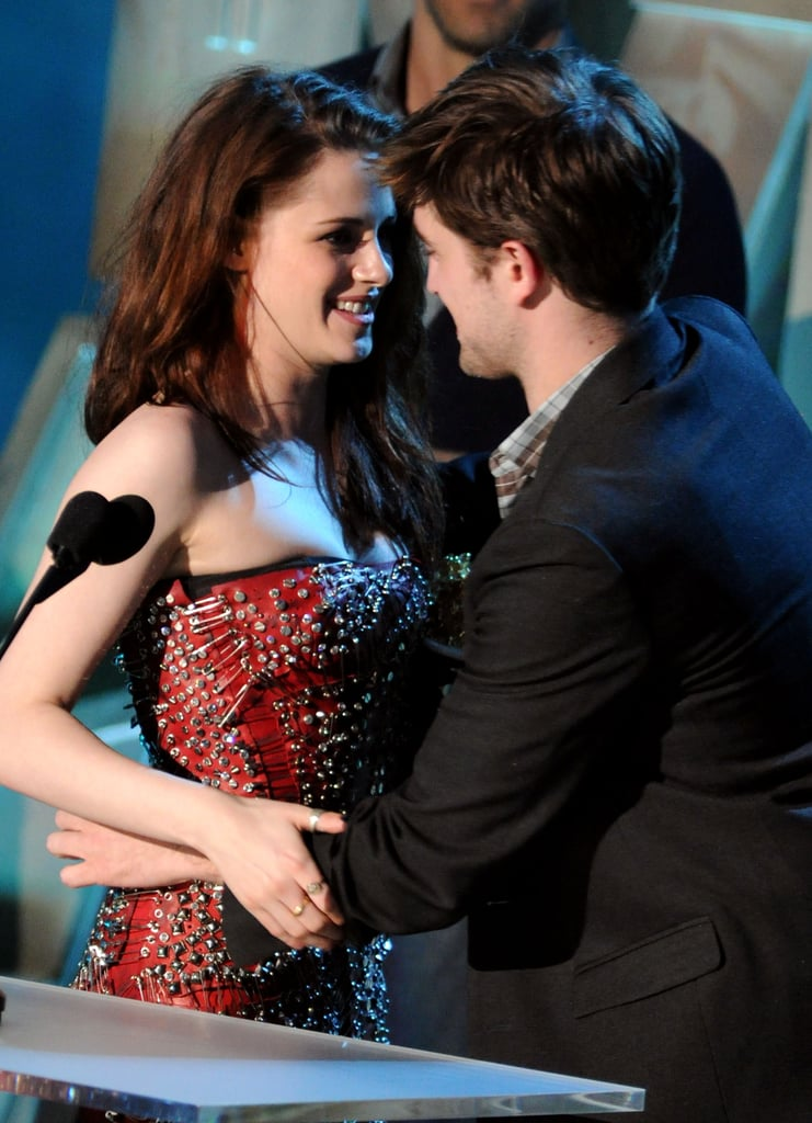 Kristen Stewart and Robert Pattinson shared a moment while accepting the best kiss award on stage during the MTV Movie Awards in May 2011.