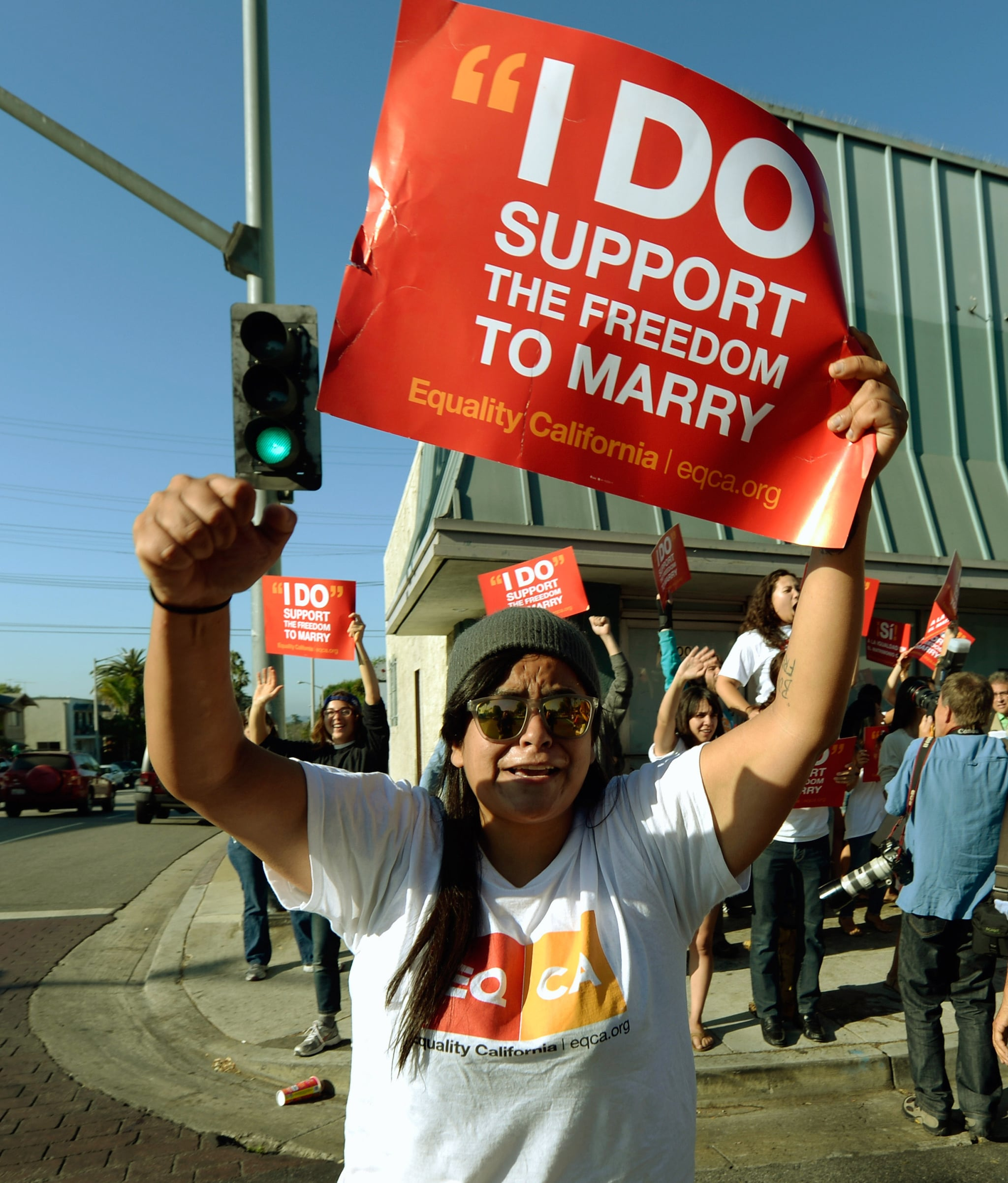 LA gay rights activists cheered in the streets upon hearing the high court's rulings.
