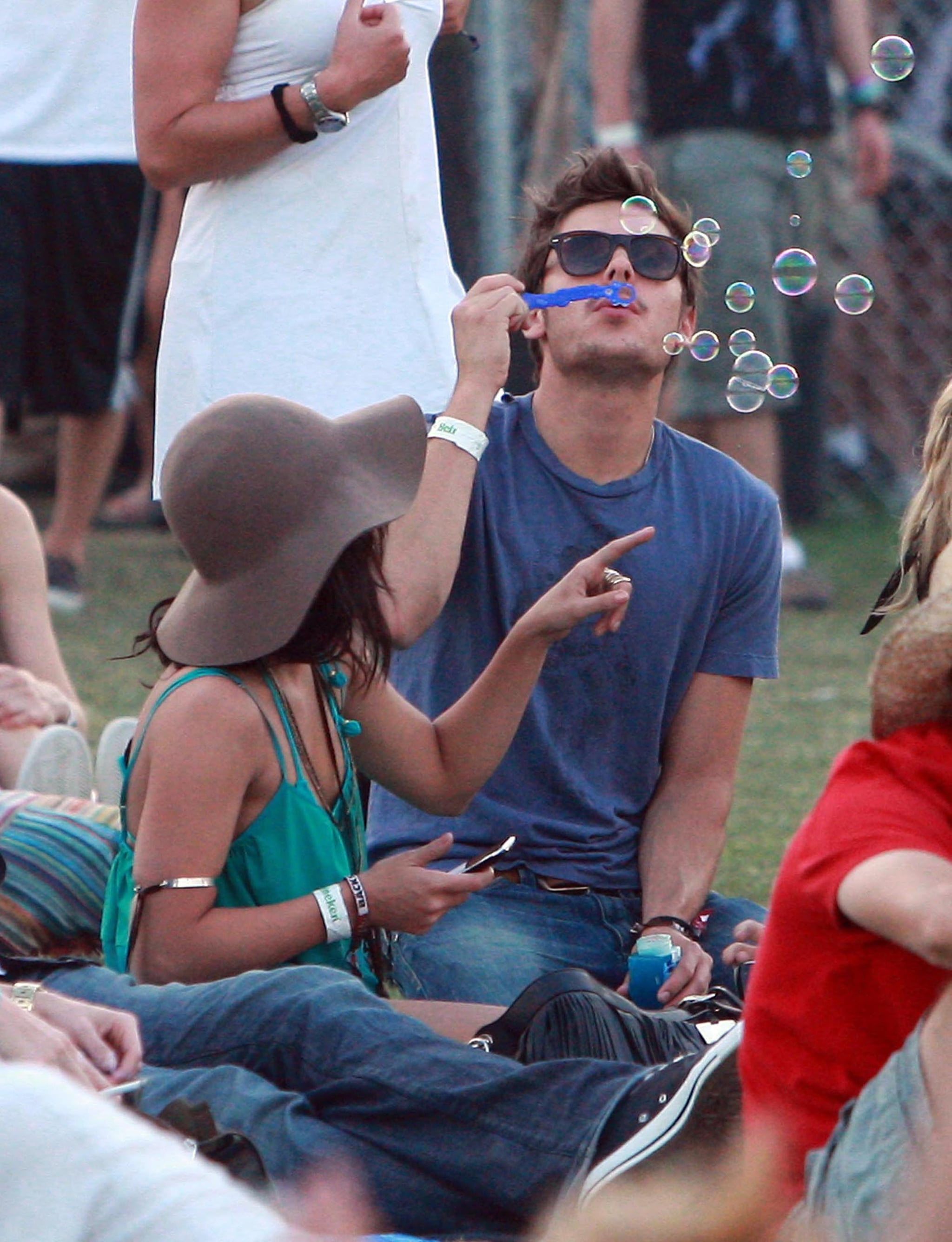Zac Efron blew bubbles while Vanessa Hudgens watched on in 2010.