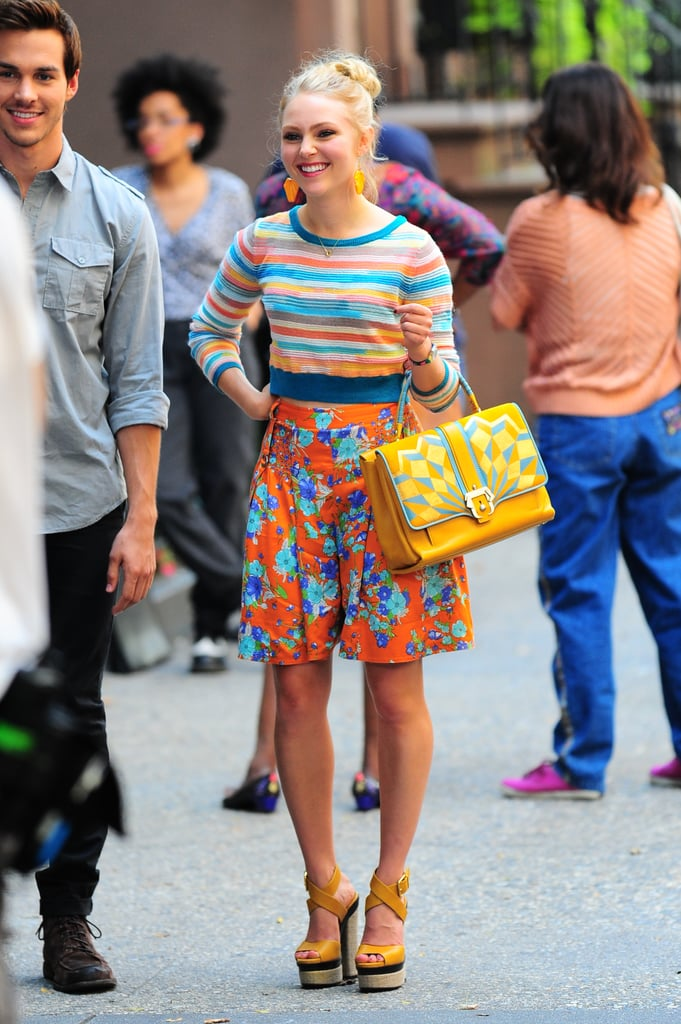 Carrie knows the key to mixing prints is finding a coordinating base color. She sported a colorful cropped sweater with high-waist floral shorts, then accessorized with a gorgeous Paula Cademartori bag. Take Carrie's bold ensemble from the streets to the beach with these tropical Josh Goot shorts ($940).