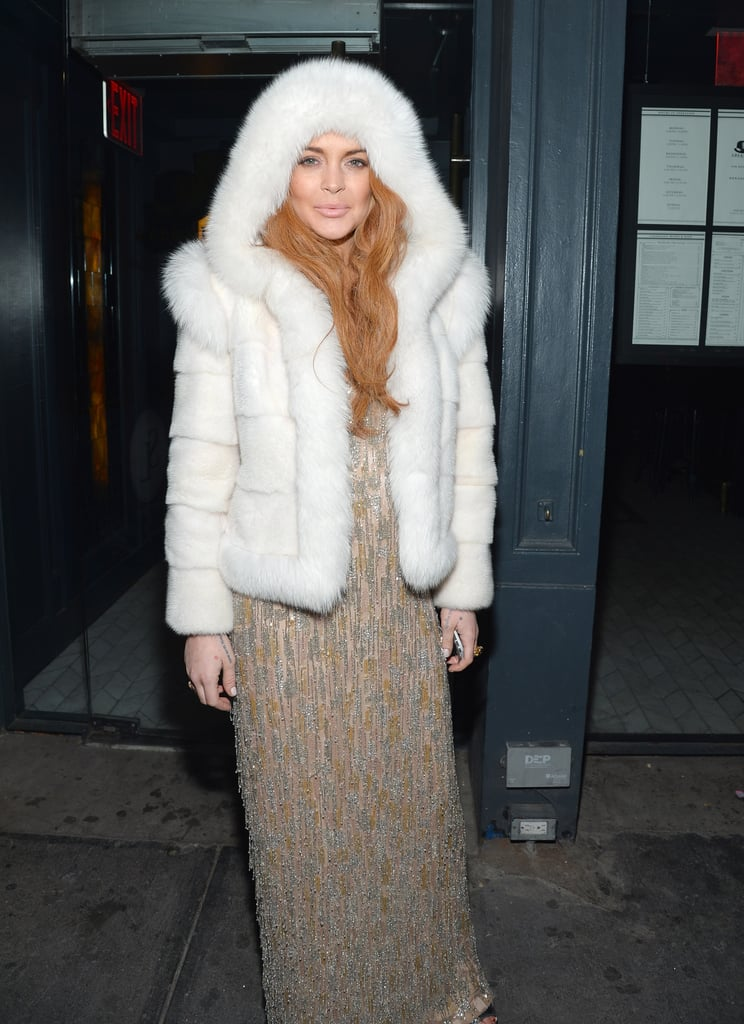 Lindsay Lohan wore white fur while waiting outside of an amfAR Gala afterparty on Wednesday night.