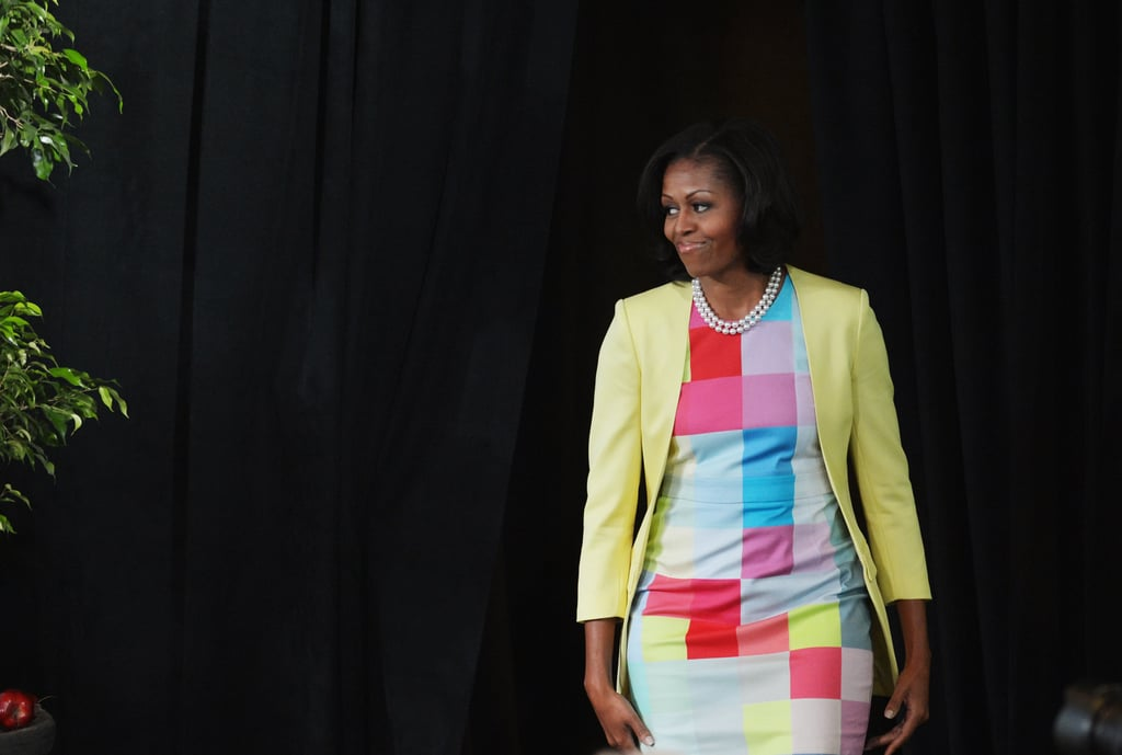 Michelle sported a pixel-print dress by Preen, which she topped with a honeydew-hued jacket.