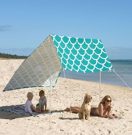 Pink Chicken's aqua, scale-printed Sombrilla ($180) makes the ultimate shelter for boho beachgoers.