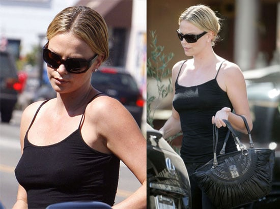 Charlize Theron Is A Woman In Black