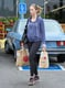 Emily Blunt showed off her growing baby bump while getting groceries in LA.