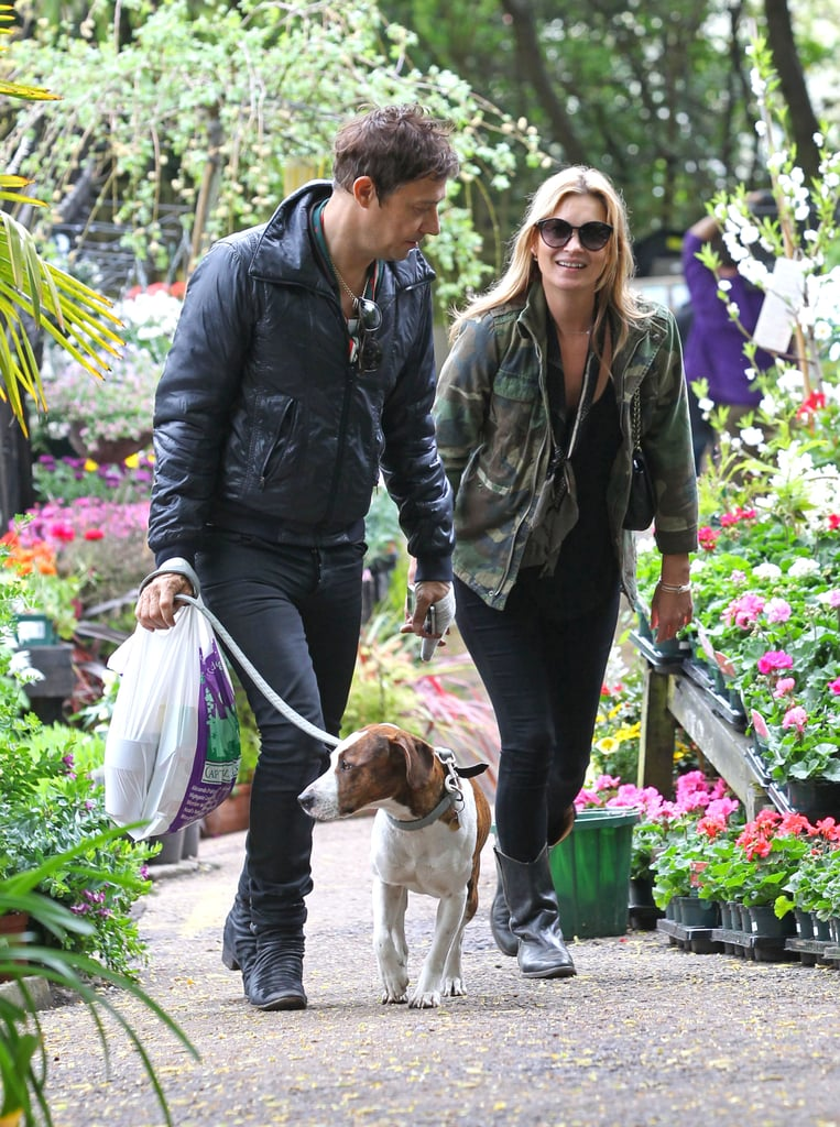 Kate was all smiles as she and Jamie took their dog, Archie, for a walk around their London neighborhood in May 2013.