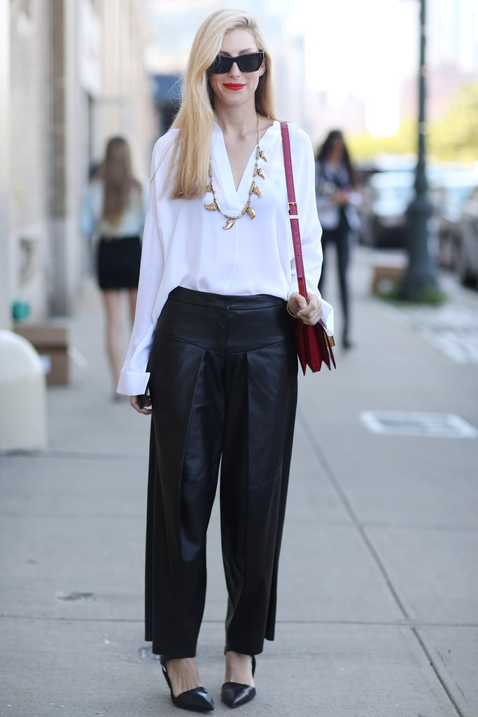 Joanna Hillman's take on white and black is anything but basic with wide leather pants and gold jewels. Source: Greg Kessler