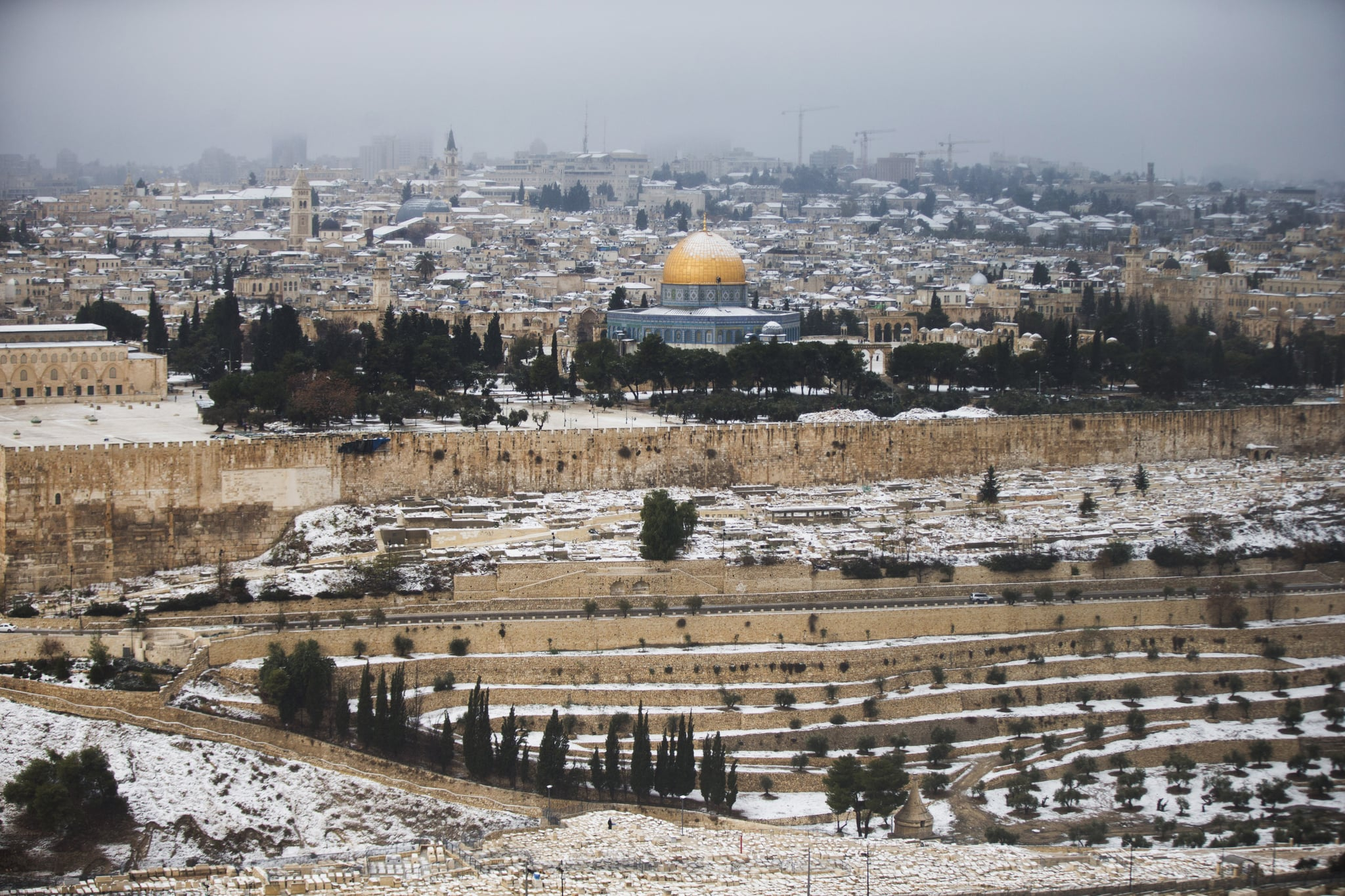 A snowstorm moved through Jerusalem, leaving the Dome of the Rock at the Al-Aqsa mosque covered with snow.