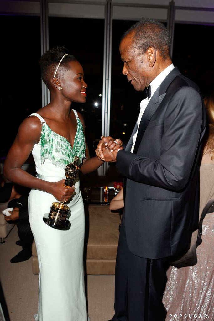 Lupita Nyong'o also had the attention of legendary actor Sidney Poitier at the Vanity Fair Oscar afterparty.