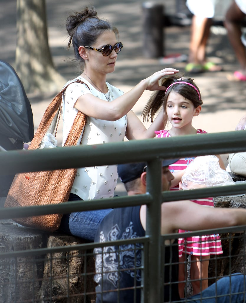 Katie fixed Suri's hair.